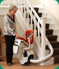 Woman preparing to use a stairlift